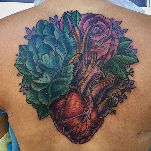 Heart and flower tattoo by @terryribera stop by Remington tattoo to book your appointment today #remingtontattoo #sandiegotattoo #hearttattoo #flowertattoo