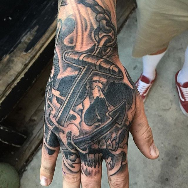 Hand tattoo by Nathaniel Gann @nathanieltattoosd #handtattoo #jobstopper #skulltattoo #anchortattoo #blackandgrey #blackandgreytattoo #remingtontattoo #nathanielgann