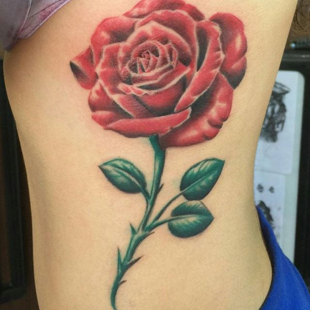 Rose side tattoo remington tattoo parlor for Rose tattoo parlor