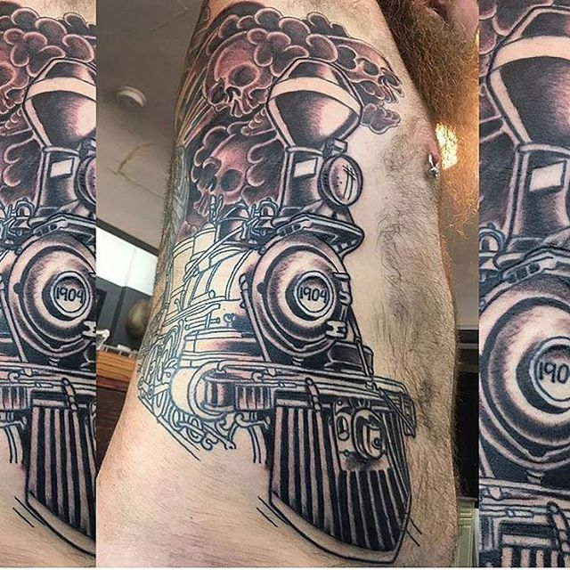Progress shot of a train tattoo by @chriscockadoodledo #traintattoo #wip #sandiegotattoo #sandiegotattooartist