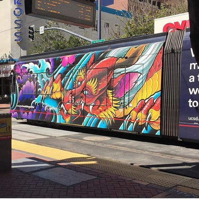 Terry Ribera @terryribera has his artwork rolling around on two trolley trains in downtown San Diego right now! #sandiego #trolley #dragon #dragontattoo #sandiegotattooshop #sandiegotattooartist #sandiegoartist #sandiegoart