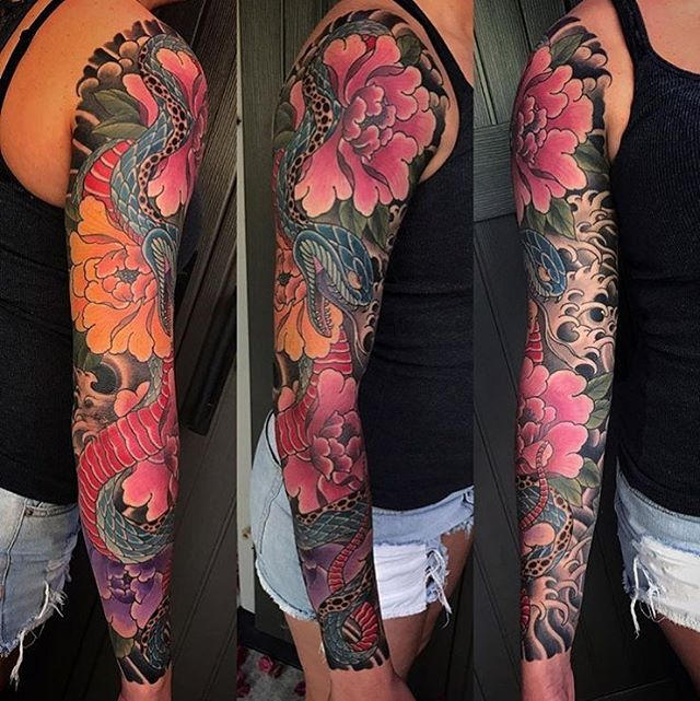 Snake and flower sleeve by @alessioricci #snaketattoo #flowertattoo #sleevetattoo #sandiegotattooshop #sandiegotattooer #sandiegotattoo #remingtontattoo #japanesetattoo #sleeve #armtattoo