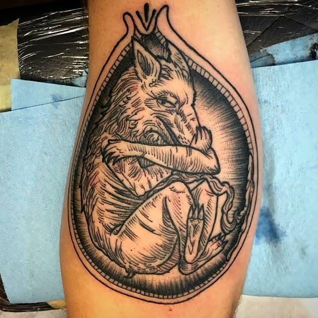 Wolf embryo by @chriscockadoodledo #tattoo #tattoos #remingtontattoo #northparktattoo #northpark #sandiegoartist #sandiegotattoo #sandiego