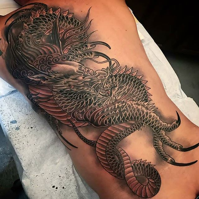 Dragon tattoo by @alessioricci #tattoo #tattoos #dragontattoo #remingtontattoo #alessioriccitattoo #northpark #northparktattoo #sandiegotattoo #sandiegotattooartist #sandiego