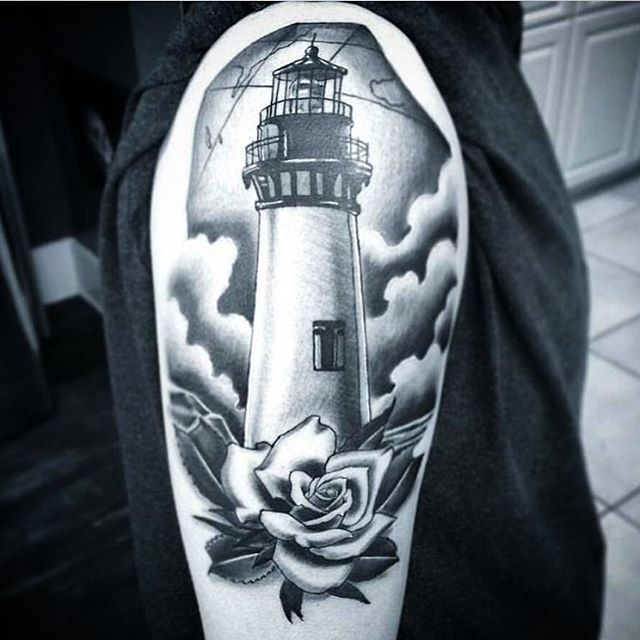 This #rose and #lighthouse #tattoo done by @gust_razotattoos at #remingtontattoo #rosetattoo #lighthousetattoo #nautical #nauticaltattoo #blackandgrey #blackandgreytattoo #ocean #oceantattoo #sandiegotattooartist #northparktattooartist #sandiego #northpark #sd