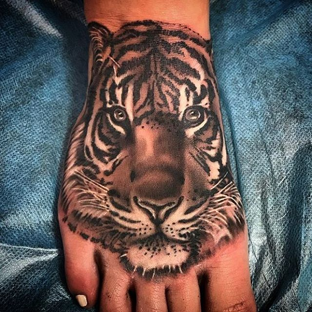 This #tiger #portrait done by @tattoosbykriskezart at #remingtontattoo #tigertattoo #portraittattoo #tigerportrait #realistic #realistictattoo #foot #foottattoo #sandiegotattooartist #northparktattooartist #sandiego #northpark #sd