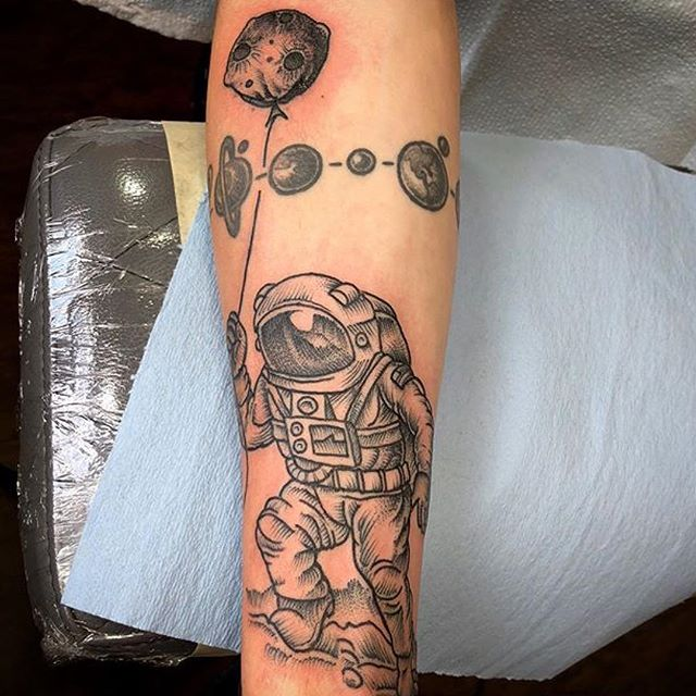 This #astronaut #tattoo done by @chriscockadoodledo at @remingtontattoo #spacetattoo #forearmtattoo #blackandgreytattoo #