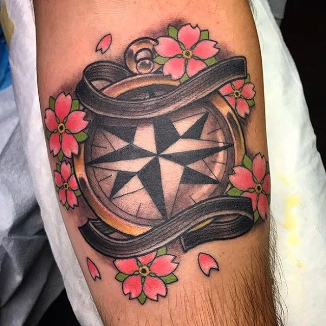 What do you think of this black-belt and compass tattoo? Done by @tattoosbykriskezart at @remingtontattoo #blackbelt #blackbelttattoo #compasstattoo #cherryblossomtattoo